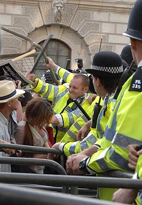 The MET try to impress Mr Bush with their method of pacifing unarmed protesters.