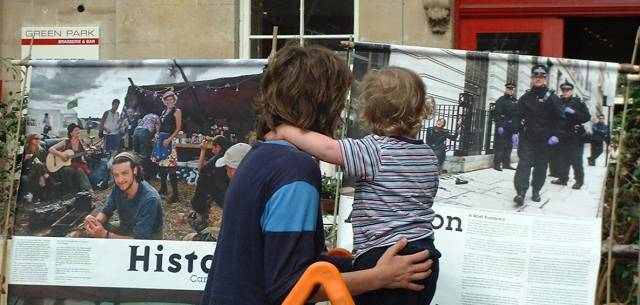 A Mother And Child Look At The Climate Camp Photo Display