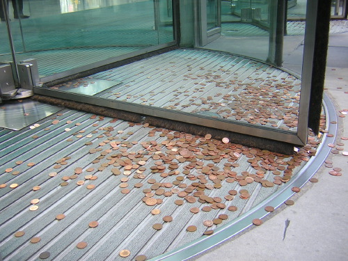 ... where bags full of pennies were thrown at the bank's entrances ...