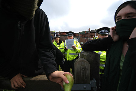 A police officer reads from the document.