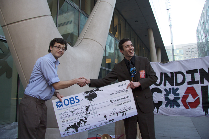 Proudly accepting the cheque.