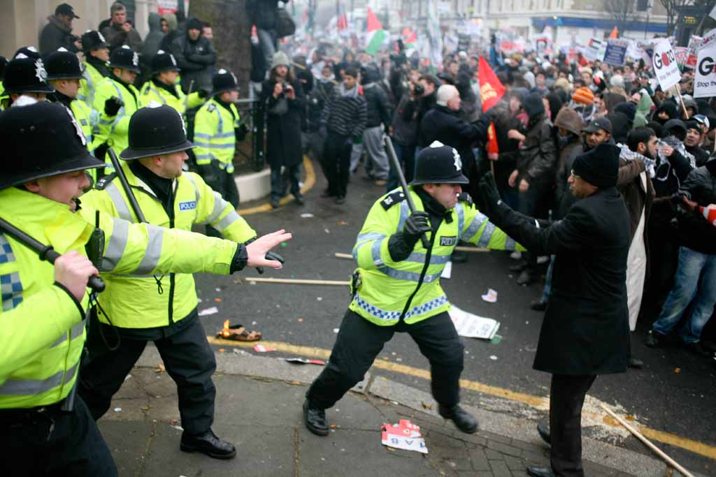 Elder protester being attacked by erratic police officer