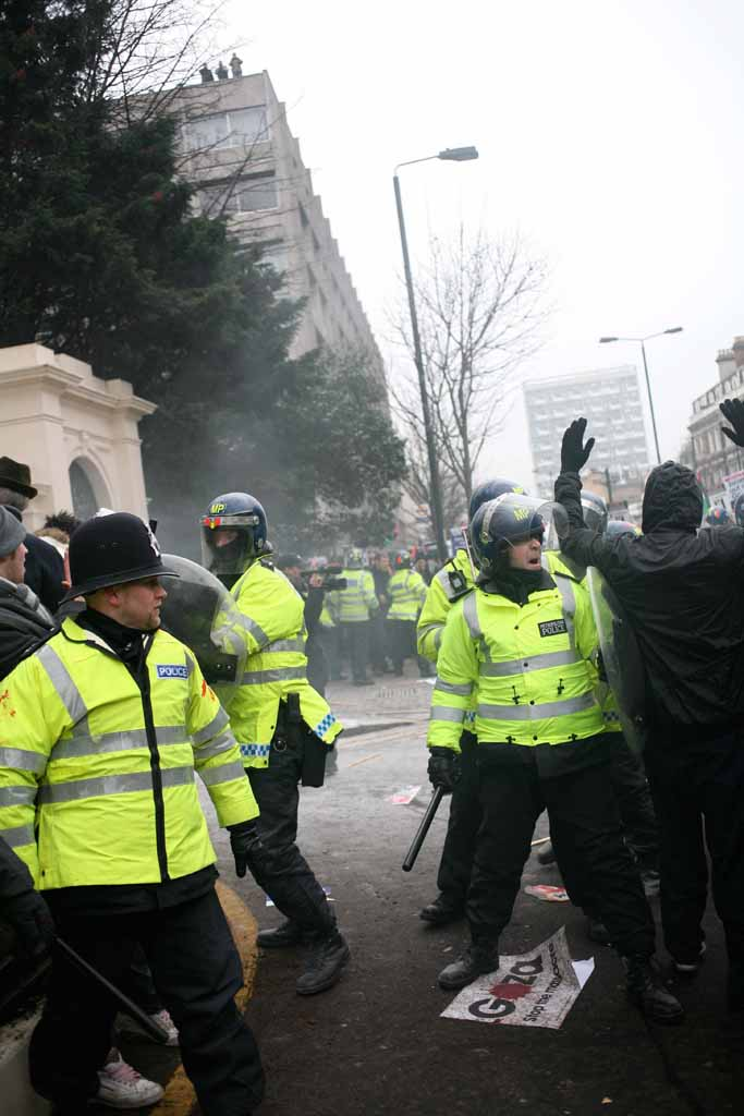 Anti-riot officers breaking in