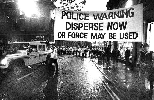 Police display a warning before attacking protesters (Photo: Tash [alan lodge])