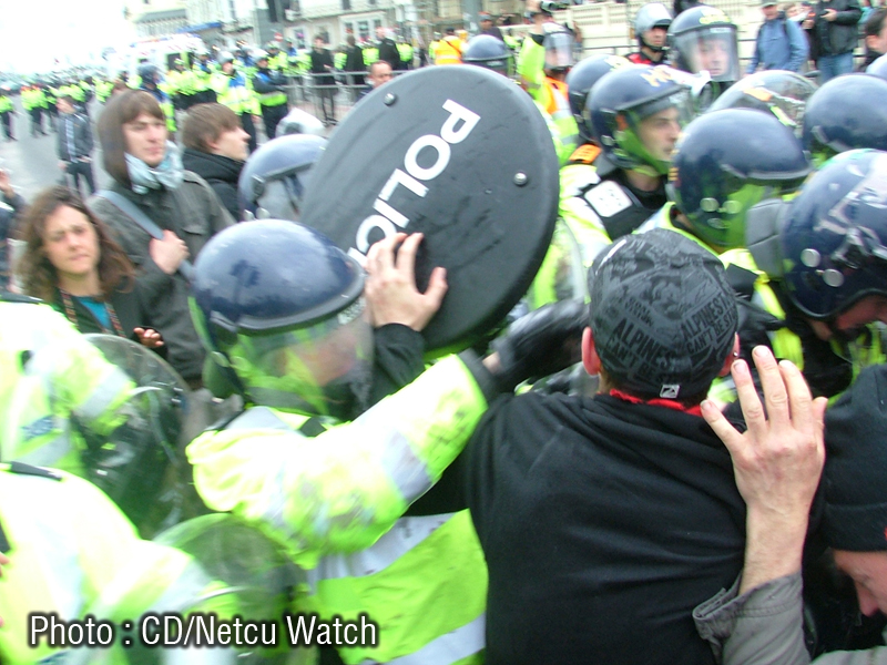 Coppers using shield as a weapon.