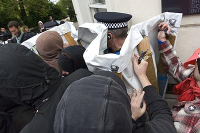 Attempts by the cops to infiltrate the demo prove unsuccessful.