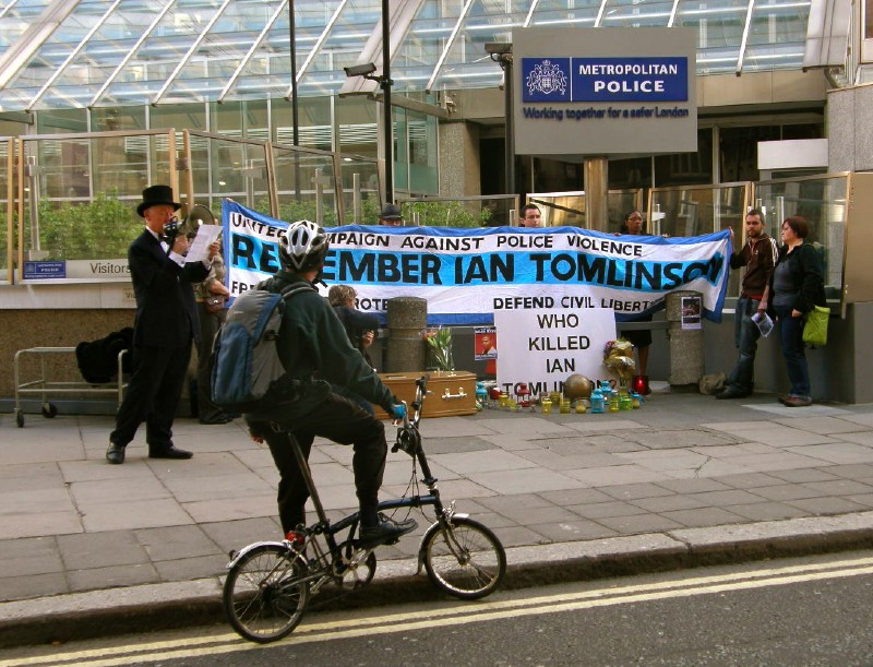 E. Cyclist lends support, as the names of dead victims of the police are intoned