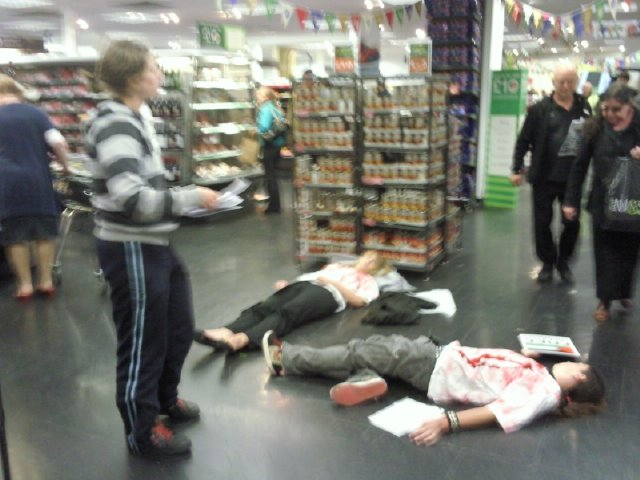 Die-in and leafleting inside the store