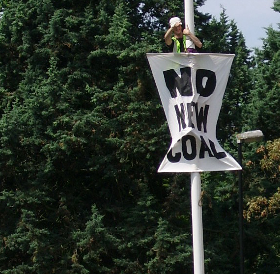 Protestor on flagpole
