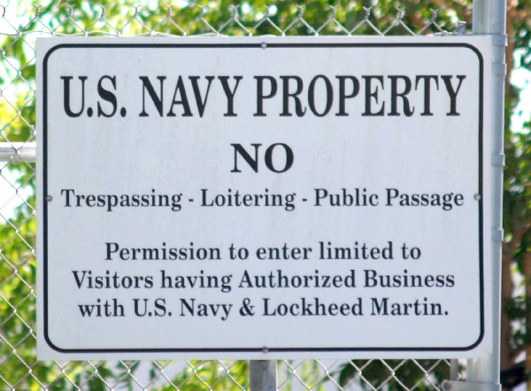 Signs indicate that Lockheed Martin Building 181 is U.S. Navy property
