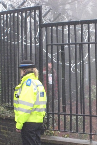 Protester inside the fence