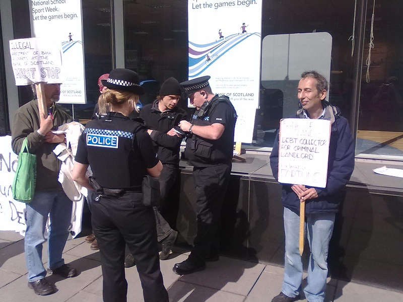 One protester enjoys the scottish sun and the chirp-chirp of the summer police