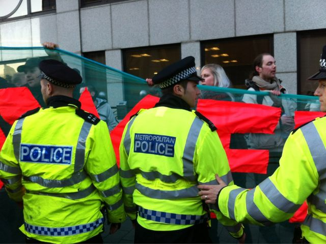 Cops try to force banner onto pavements