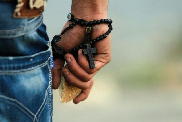 A Palestinian Christian protests against attacks on GAZA, Bir Zeit, 19.11.12