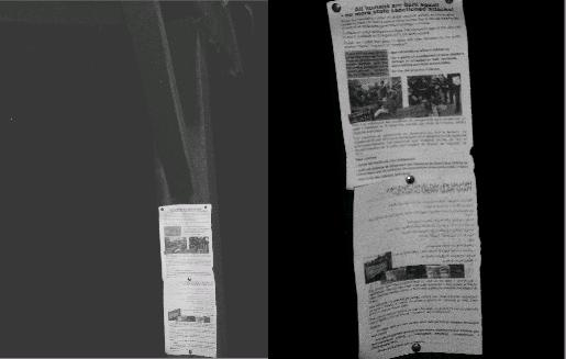 Leaflets are attached to the gate posts in four languages