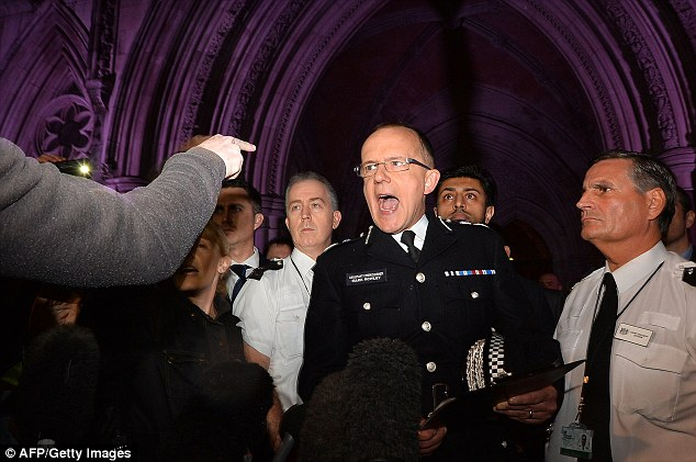 Assistant Commissioner Mark Rowley challenged by protesters outside the court