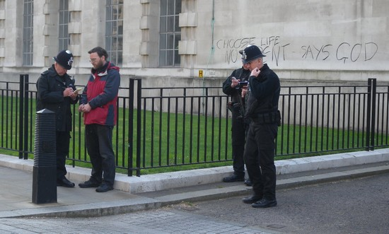 Fr Martin being arrested after daubing message in ash on Ministry of Defence