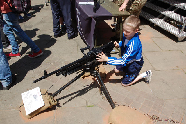 small child plays with gun