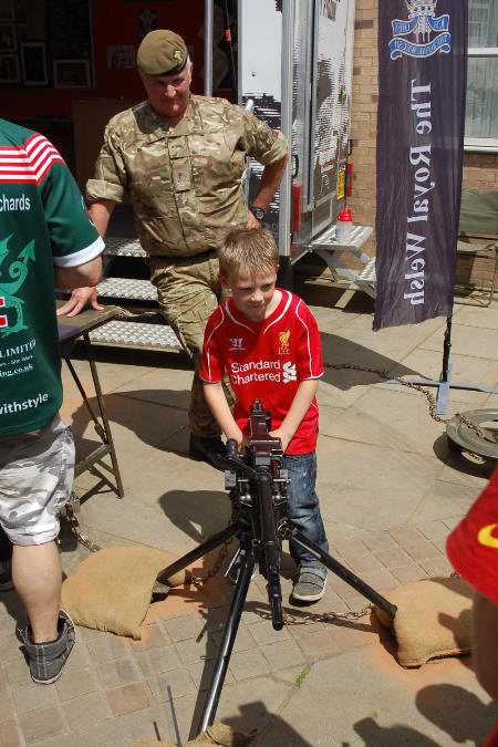 another small child encouraged to play with weaponry