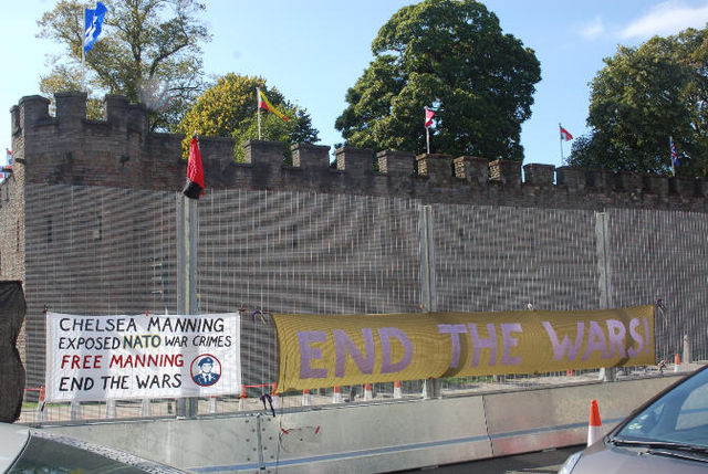 Banners on the fence round Cardiff Castle on Sunday