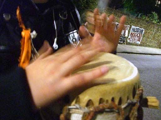 Noise at the protest was provided variously by drums...