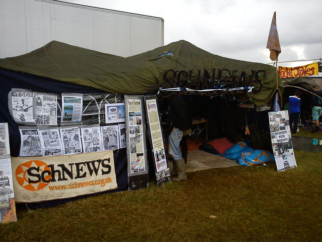 Schnews stall at Boomtown Festival