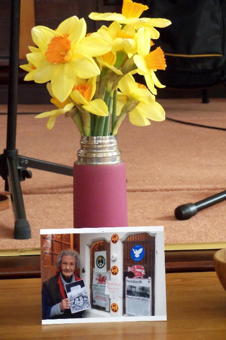 Flowers for Lib (photo of her at front door complete with Free Manning stickers)