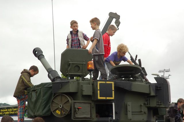 Children play on a tank
