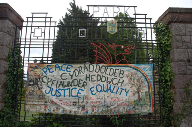 Peace, Justice, Equality banner on the park gates