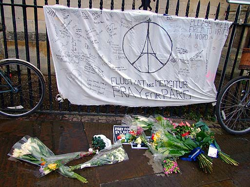 The Paris street shrine was passed by the march, outside of Great St Marys.