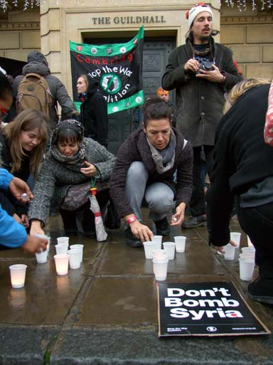 Despite wet, blustery weather, a diligent attempt was made to light candles.